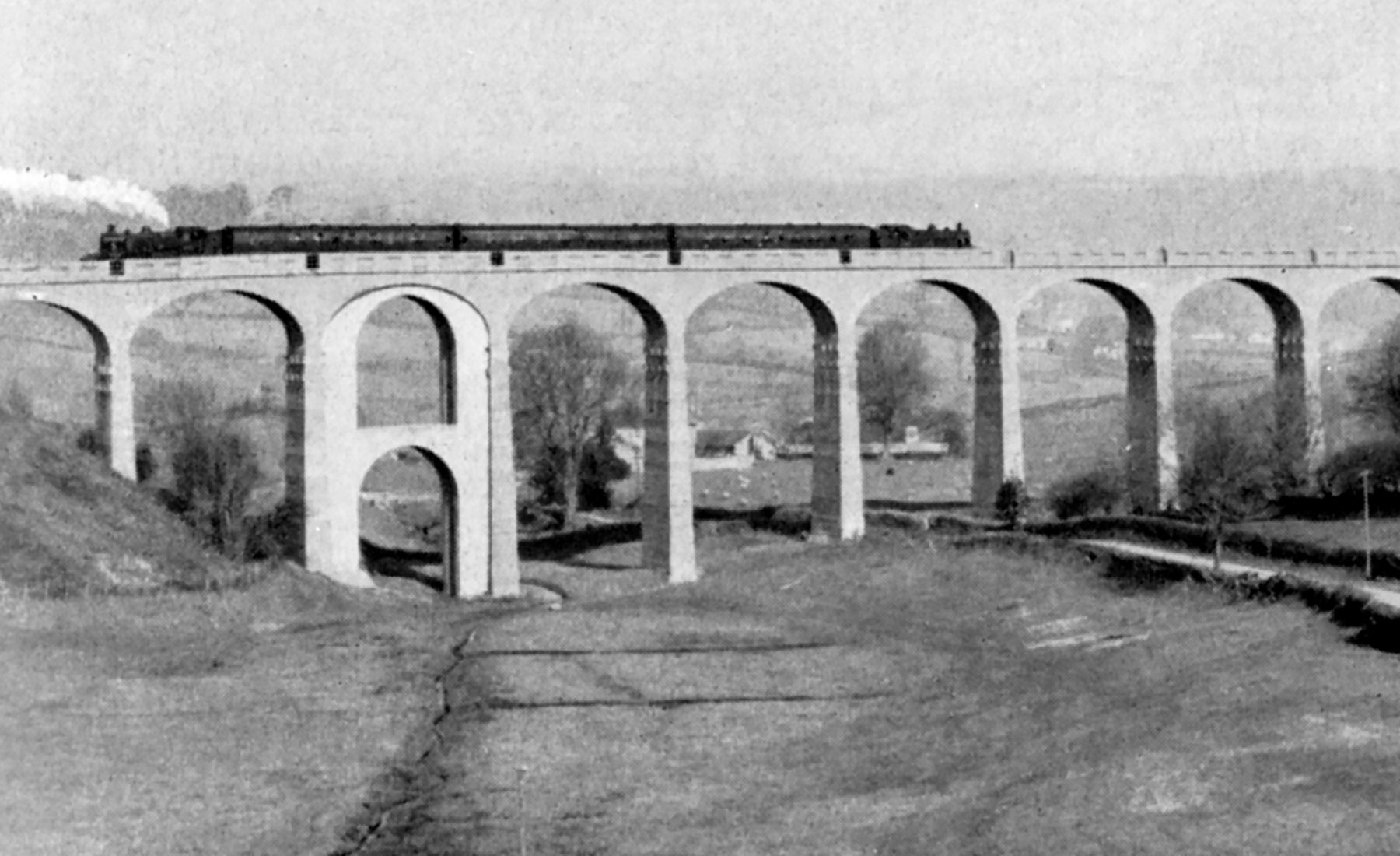Pacific No 35022 crossing Carrington Viaduct 7th March 1965